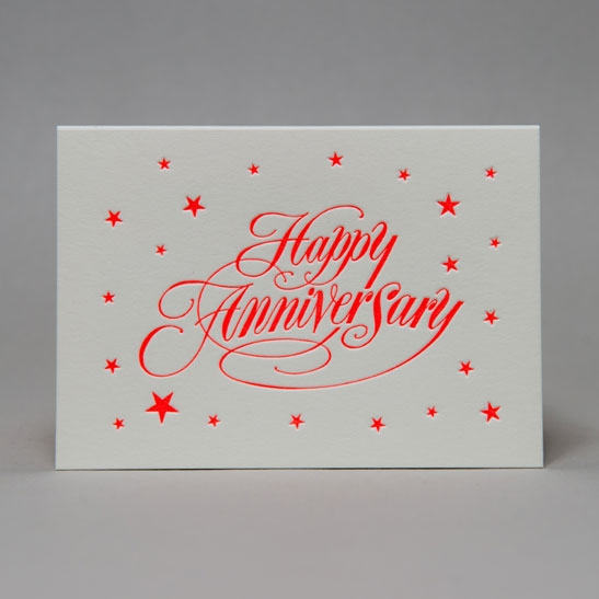 Happy Anniversary star background in fluoro orange