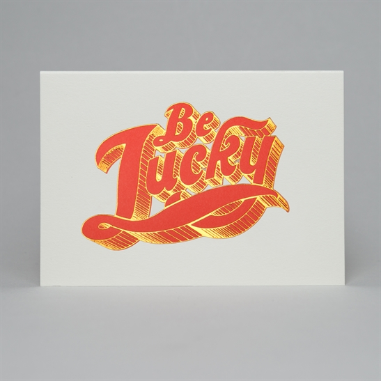 Be Lucky letterpress & foil card in fluoro orange & copper